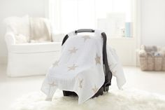 travel essentials for babies: the cotton muslin car seat canopy from aden + anais keeps your baby cool and covered