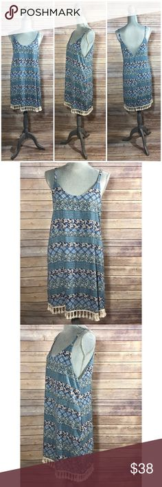 Patterned Sleeveless Dress with Tassels Tassel hemline; scoop neck front; Sleeveless; unlined; hidden side seam pockets; 100% polyester; style: D10380; condition: excellent. Lila Clothing Co.  Dresses