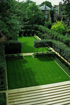 Yew cubes, pleached hornbeam, and boxwood hedges frame a lawn in London. Designer Luciano Giubbilei garden design Rooms With a View