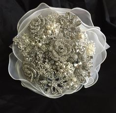 Stunning silver tone brooch bouquet with handmade organza ribbon.