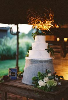 Use an upside down bucket to raise up a round platter or drink dispenser for an outside get together.  Forget the wedding cake. Lol