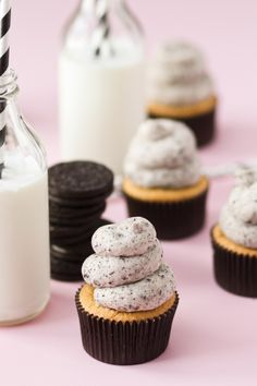 Cookies and Cream Cupcakes -- Vanilla Cupcakes stuffed with Oreos and Oreo Filling and topped with Vanilla Oreo Frosting