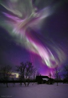Aurora Borealis, or the Northern Lights, as appeared over a small sami village in Lapland, northern Sweden