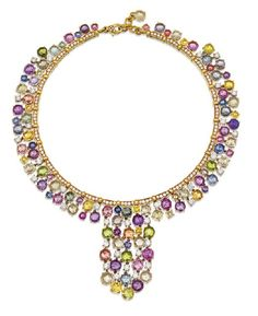 Diamond and multi coloured sapphire necklace, Bulgari, of bib design the flexible collar designed as a line of diamond set scalloped edge baton links supporting an elaborate fringe of fancy coloured rose cut sapphires together weighing 79. 65 carats, spaced at intervals by round brilliant cut diamonds, the diamonds together weighing approximately 13. 79 carats, mounted in 18ct gold, signed Bvlgari. Length approximately 309mm.