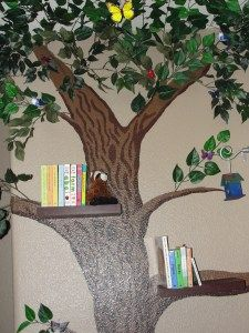 A tree mural as a book shelf