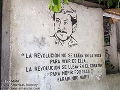 """Revolutionary FMLN sign in Cinquera, El Salvador. """"The revolution is not carried in the mouth to live it, the revolution is carried in the heart to die for it."""" -- Farabundo Marti"""