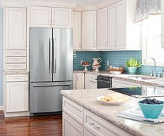 Spot-On Storage - I like the blue tones along with the light cabinets and countertops; maybe turn the area to the left of the fridge into a beverage area for coffee, tea other beverage items.
