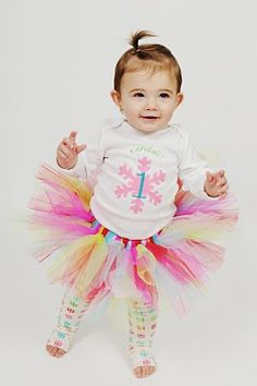 This is the t-shirt I am making to go with her tutu! I don't think I'm going to do the leg warmers though because the floor in the party room is tile and I don't want her to slip!