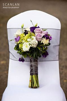 hand-tied bouquet  green hydrangea, purple sweet peas, green lisianthus, lavender stock, white spray roses and lavender roses