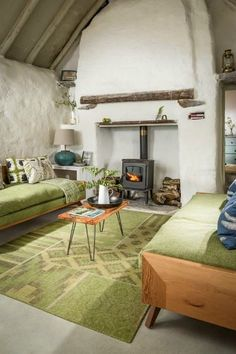 Home Design This Traditional Cottage Features White Rough Walls And Rough Wooden Beams Also Black Vintage Fireplace Next To Lime Green Cozy Sofa And Antique Brown Coffee Table And Green Rug Classic Irish Cottage With A Pastoral Landscape Around