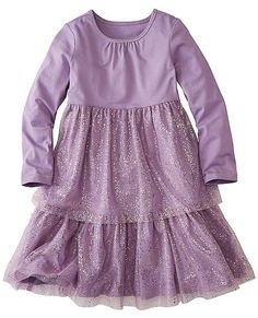 Dressed up with loads of twirl potential on the outside, and supersoft and comfy on the inside. Dress up or play, it's ready either way.  <br> •100% cotton jersey<br> •Gold flecked poly mesh tulle overlay<br> •Soft gathers at neckline<br> •Empire waist<br> •Twirly hem sweep<br> •Prewashed<br> •Imported