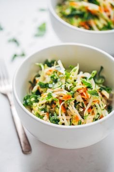 Vietnamese Chicken Salad with Rice Noodles made with chicken, cabbage, carrots, homemade dressing, lime juice, mint, and cilantro.