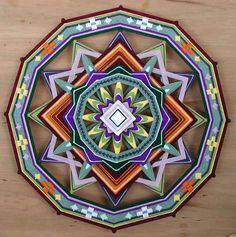 Shield of Love, a 24 inch, wool yarn, Ojo de Dios, by Jay Mohler