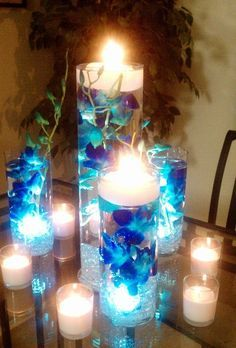 blue orchids submerged in vases filled with water and floating candles on the top for an adorable wedding reception centerpiece that's the idea I'm using for my wedding decorations Wedding Reception Centerpieces, Wedding Table, Our Wedding, Dream Wedding, Wedding Decorations, Trendy Wedding, Wedding Beach, Wedding Ideas In Blue, Table Decorations