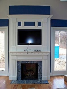 sunroom fireplace, tv above fireplace by BeaglesDoItBetter, via Flickr