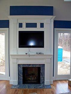 sunroom fireplace, tv above fireplace by BeaglesDoItBetter, via Flickr
