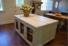 Jane Wood Interiors used an antique shop counter and topped it with a slab of white marble.