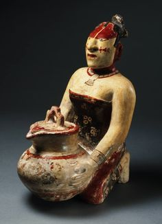 Late Classic, Maya Place made: Maya area, Belize, Guatemala, or Mexico Kneeling noble woman holding a lidded jar, A.D. 650–750 Ceramic with polychrome slip Princeton University Art Museum