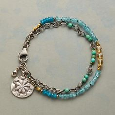 SOLARIUM BRACELET -- Golden citrine and a sunburst charm light up our two-strand mix of apatite, turquoise, hematite and brass beads. Sterling silver gemstone bracelet