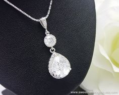 Option 8 - Wedding Necklace Bridesmaid Necklace Bridal Jewelry Bridesmaid Necklace Clear White (L) Cubic Zirconia Tear Drop LUXURY Necklace. $32.00, via Etsy.