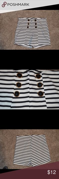 Striped High Waisted Shorts NWOT! Never worn. Super cute black and white striped shorts. Adorable buttons on the front and goes perfect with the red crop top also listed in my closet. Stretchy material and true to size. vitta luna Shorts