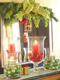 Glass with ornaments and candles. Dining room table idea.