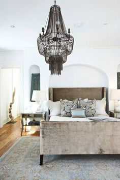 Love love love this bedroom! The chandelier and bed are stunning.
