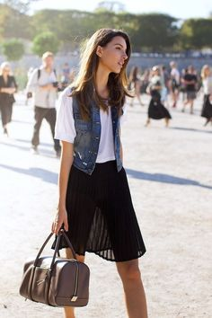 Kate King // denim vest, white tee, brown leather duffle bag & black pleated skirt #style #fashion #modeloffduty #streetstyle