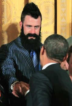President Barack Obama greets San Francisco Giants baseball pitcher Brian Wilson