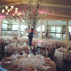 Tall centerpiece, curly willow, dendrobium and hydrangea
