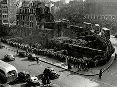 31st May 1955 - Hundreds queue at a bus stop in Farringdon as a result of train strikes in London