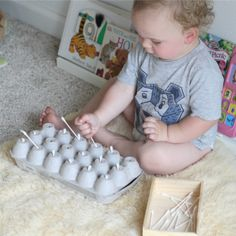 Q-tip Push: A Fun Baby Activity - Happily Ever Mom