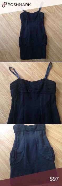 Sale TodayAlice + Olivia black mini dress Good condition no fading no stains no rips.The dress has 2 pockets and zipper in the back.Length from the straps is 30 1/2 long.Material 75% Rayon 20% Nylon 5% Spandex.Dry clean only.Price drop from $70.No Offers Accepted Alice + Olivia Dresses Mini