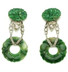 A pair of jadeite jade and diamond pendant earrings mounted in platinum.