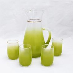 """Bright mid century modern Blendo handmade glass pitcher and four tumblers by the West Virginia Glass co. Vintage retro and ombré trendy at the same time. Bright lime green with gold trim. Nice for serving juice or as retro barware. Pitcher measures: 5 1/2"""" x 9"""" x 4 1/2""""; Tumbler measures: 2 1/4"""" ..."""