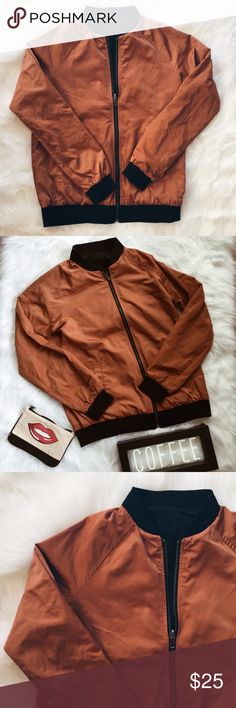 F21 Rust/Black Patches Reversible Bomber Jacket ▪️Product Description▪️ ▫️Reversible Bomber Jacket ▫️One side- rust color orange and black for the more neutral outfits and the other side- black with fun patches for the bold looks  ▫️Never been worn  ▫️Silky material for the jacket body and cozier material that hugs the hips, wrists, and neck   ▪️Fit: True to size, comfortably takes small-medium ▪️Condition: NWOT  ▪️Measurements: Approx/Laying Flat  ▫️Waist/Bust: 20 inches  ▫️Arm: 28 inches…