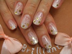 milky white gradient with gold stars nail art or hearts