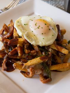 #Poutine with Hand-Cut Fries, Crispy Scallions, Smoked Bacon, Cheese Curd, Rich Demi-Glace, and Fried Egg is one of the Chef's Specials for December at Glenmorgan.