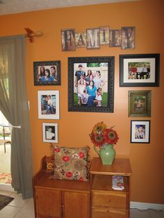 """Family Photo Wall...I just like the """"FAMILY"""" plaque. :)"""