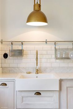 "Brass, aged gold and black hardware ""Chrome, nickel and stainless steel are no-longer the go-to for kitchen metals anymore,"" Erin says. Inst..."