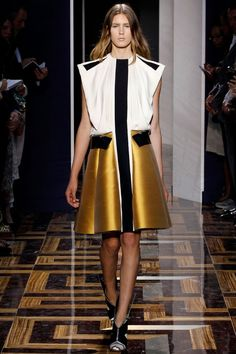 Designer work inspired by 1960s fashion - Balenciaga Spring 2012 creates a space look with geometric pieces of stiff 1960′s fabric