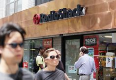 NEW YORK, NY -   People walk past a RadioShack store in Manhattan on July 26, 2012 in New York City. Following poor second quarter earnings, the electronics chain was hit with a ratings downgrade and shares fell to an all-time low.  Eight Retailers That Will Close the Most Stores: Best Buy, Sears, J.C. Penney, Office Depot, Barnes & Noble, Gamestop, Office Max, and Radioshack.   http://finance.yahoo.com/news/eight-retailers-that-will-close-the-most-stores-173320796.html?page=2