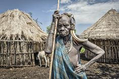 """""""Old Mursi woman"""". Old woman by the huts of her village. Location: Marenke, Omo valley, Ethiopia. (Photo and caption by Jorge Fernandez/National Geographic Traveler Photo Contest) http://avaxnews.me/appealing/ALL_2013_National_Geographic_Traveler_Photo_Contest_in_HIGH_RESOLUTION_Part2_Travel_Portraits_Weeks_1-10.html"""