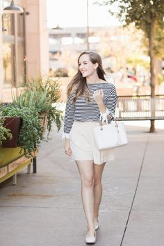 Creating modest outfits is easy when you find the perfect pair of dressy high-waisted shorts. Learn how to style them for the office, a bridal shower or brunch. You can easily create a Parisian outfit by adding a striped tee and a classic quilted handbag.