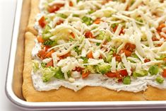 These easy veggie pizza appetizer squares feature lots of veggies and cheese, loaded onto crescent rolls, for a colorful, delicious snack!