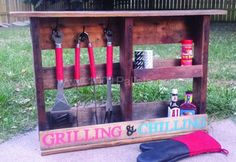 "Grilling Shelf Out Of Pallet Wood Pallet Shelves ~ Just one fully entire pallet was used. Dark walnut stain, hand lettered. ""&"" is a hook as well as the three hooks on the left side for the utensils. Two shelves for grilling products such as bbq sauce, seasoning, etc. The additional hook can be added on the side for hot mitt, grill brush, etc…"