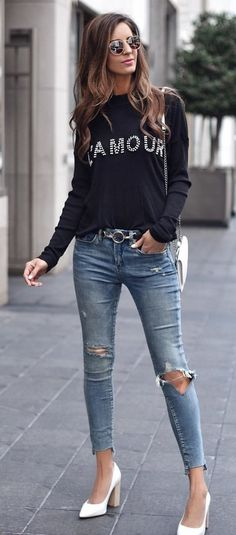 #spring #outfits woman wearing black sweater and blue denim pants taking picture during daytime. Pic by @myviewinheels