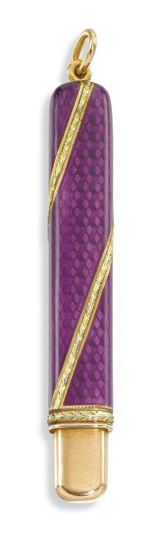 A Fabergé two-colour gold-mounted enamel pencil, workmaster Anna Ringe, St Petersburg, 1899-1903 -