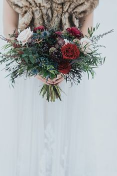 Emerald Lake winter Wedding bouquet with thistles, roses, carnations and greenery wedding flowers Emerald Lake winter Wedding Emerald Lake wedding Photographer Christmas Wedding Bouquets, Winter Bridal Bouquets, Red Bouquet Wedding, Winter Bouquet, Winter Wedding Flowers, Bridal Flowers, Red Wedding, Vintage Bridal Bouquet, Blue Bouquet