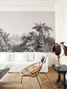 black and white tropical mural wallpaper in living room   via coco kelley